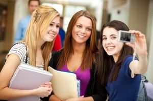 High School: Pretty Teens Take Photo in School